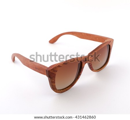 modern fashion retro wooden sunglasses with tinted lenses from the front on a white background