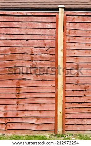 Modern fence panel in a garden - stock photo