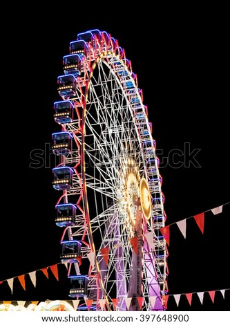 Modern ferris wheel in the night. Free time activities. - stock photo