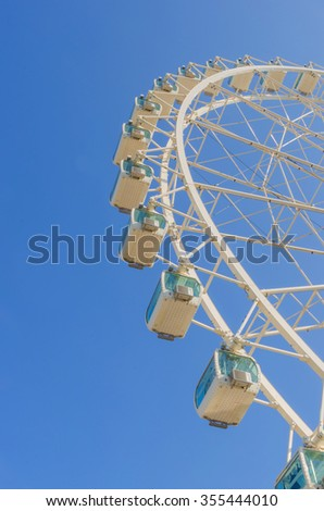 Modern ferris wheel in white with cabinets. Noria - stock photo