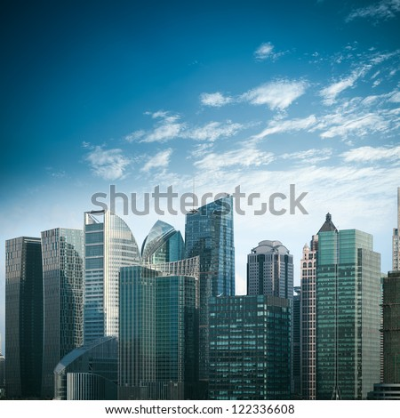 modern financial buildings against a blue sky in shanghai - stock photo