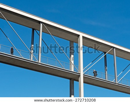 modern footbridge in front of blue sky - stock photo