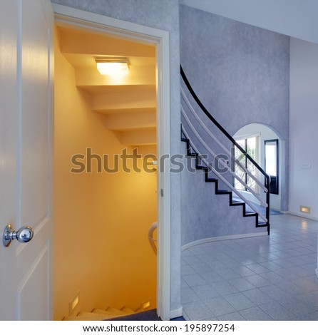 Modern foyer. View of staircase to basement - stock photo