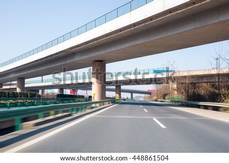 modern freeways and the highway interchange with motion blur - stock photo