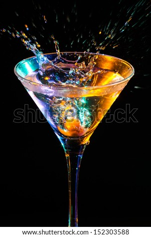 modern fresh coctail on the black background - stock photo