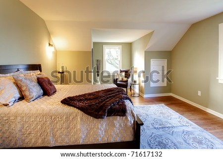 Modern fresh green bedroom wtih oak floor and browns bedding