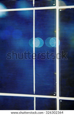 Modern freshly installed photovoltaic solar panel on the roof of a school in Germany - stock photo