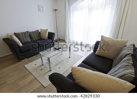 modern furnished living room with arched window - stock photo