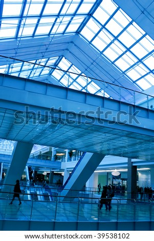 modern futuristic corridor in airport - stock photo