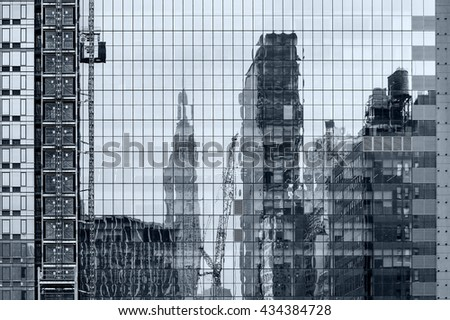 modern geometric abstraction glass windows and reflectionon a skyscrapers - stock photo