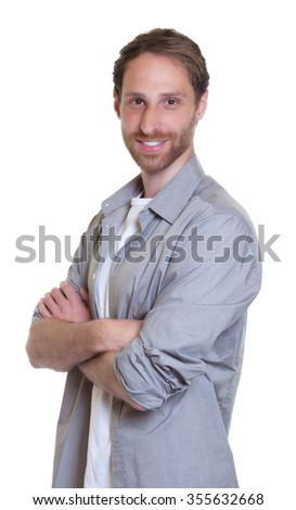 Modern german guy with beard and crossed arms in grey shirt