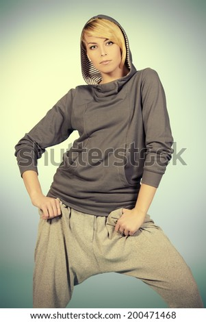 Modern girl dancer dancing in hip-hop style. Urban street style. - stock photo