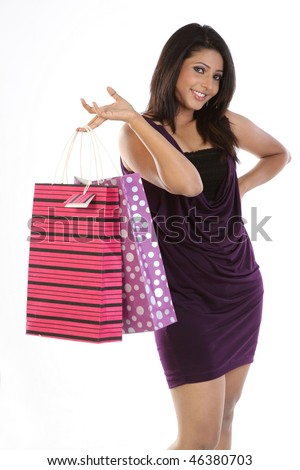 Modern girl in skirt holding shopping bags - stock photo