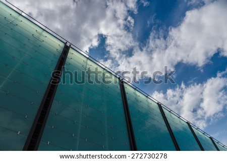 Modern glass architecture building cloudscape diagonal view - stock photo