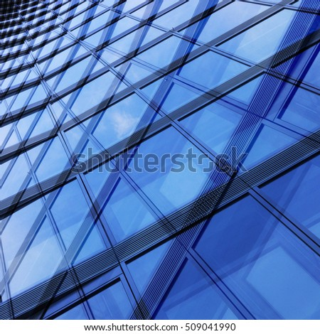 Modern glass architecture with reflections. Tilt double exposure close-up photo of walls with structural glazing. Realistic though fictional office / public building fragment.