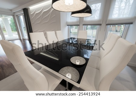 Modern glass black and white dinning table - stock photo