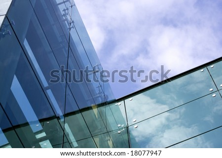 Modern glass building - sky and clouds reflection