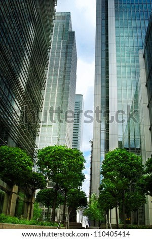 Modern glass buildings with trees.