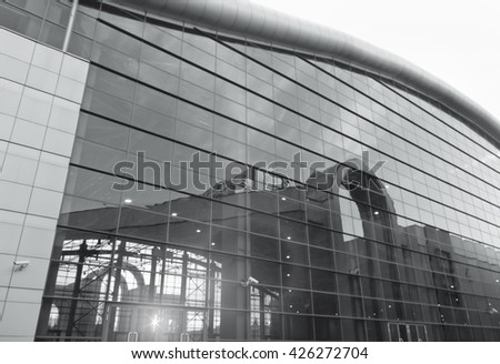 Modern glass hangar, a large building with reflection on glass