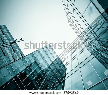 modern glass silhouettes of high rise skyscrapers at night - stock photo