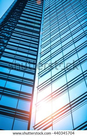 Modern glass silhouettes of skyscrapers in the city, blue business building.
