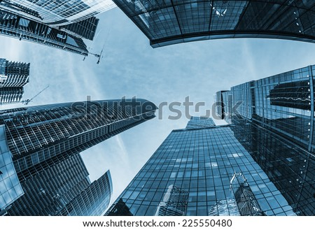 Modern glass silhouettes of skyscrapers in the city. toning - stock photo