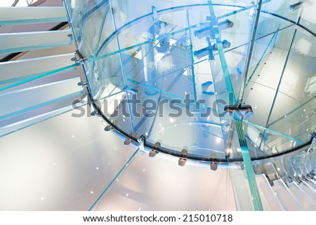 Modern Glass Staircase Silhouette of walking People in shanghai china. - stock photo
