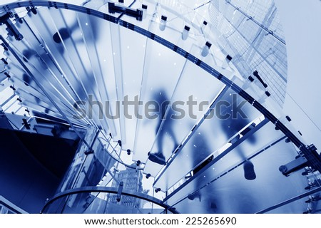 Modern Glass Staircase Silhouette of walking People in shanghai china - stock photo