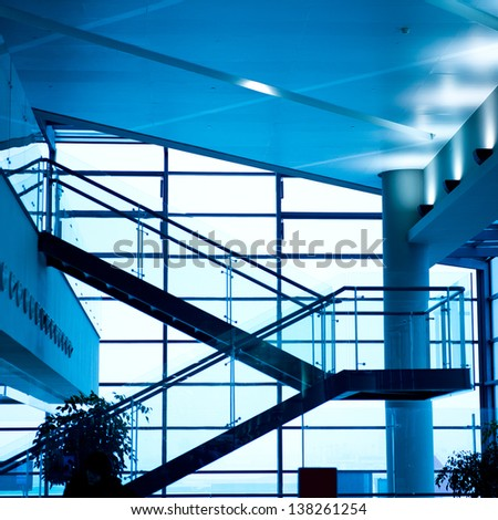 Modern glass staircase with metallic hand-rails. - stock photo