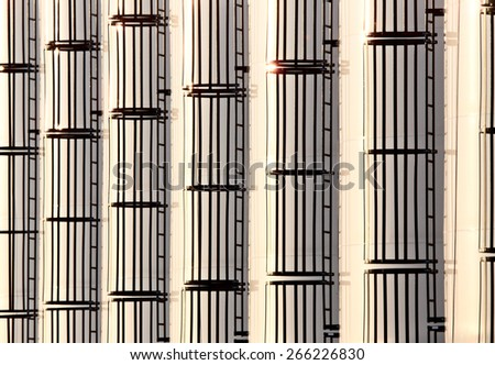 Modern Granaries with ladder pattern agriculture Saskatchewan Canada - stock photo