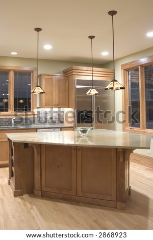 Modern granite and wood kitchen