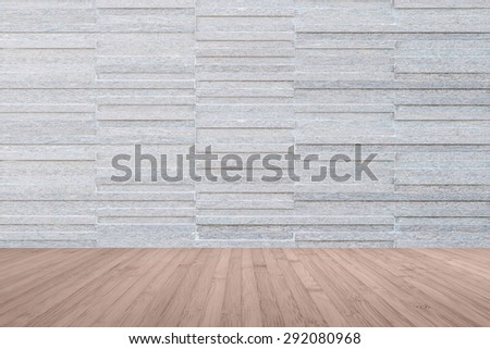Modern granite tile wall pattern textured background in dark grey color with wooden floor in red brown color tone : Horizontal stone tile wall pattern texture with wood flooring      - stock photo