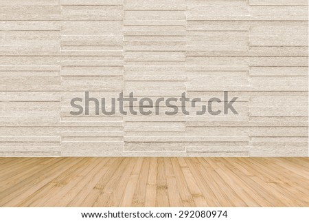 Modern granite tile wall pattern textured background in light cream beige brown color with wooden floor in yellow cream color : Horizontal stone tile wall pattern texture with wood flooring         - stock photo