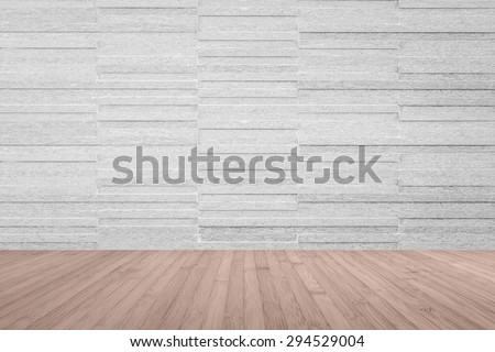 Modern granite tile wall pattern textured background in light grey color with wooden floor in red brown color tone : Horizontal stone tile wall pattern texture with wood flooring      - stock photo