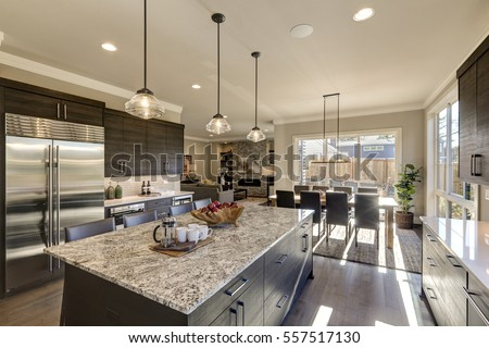 Modern Gray Kitchen Features Dark Gray Cabinetry Paired With White Quartz  Countertops And A Glossy Gray