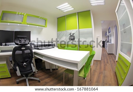 Modern green and white office - stock photo