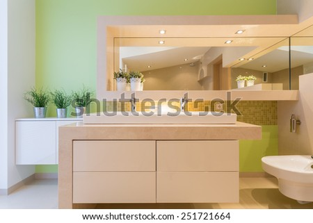 Modern green bathroom in luxury mansion - stock photo
