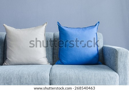 modern green sofa with blue and grey pillows in living room