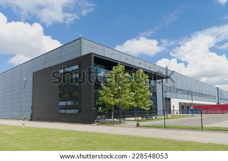 modern grey warehouse in the Rotterdam harbor area