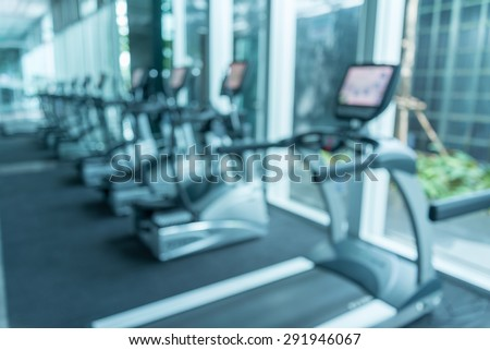 Modern gym fitness center abstract blur background