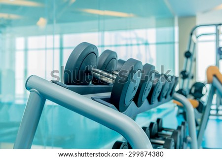Modern gym with various sports equipment - stock photo
