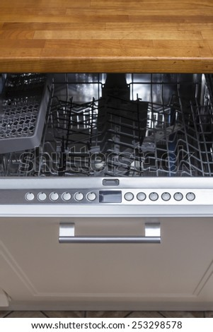modern Half open empty dishwasher in a modern kitchen - stock photo