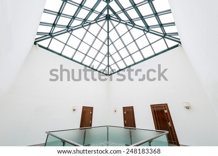 Modern hall with glass banister and roof