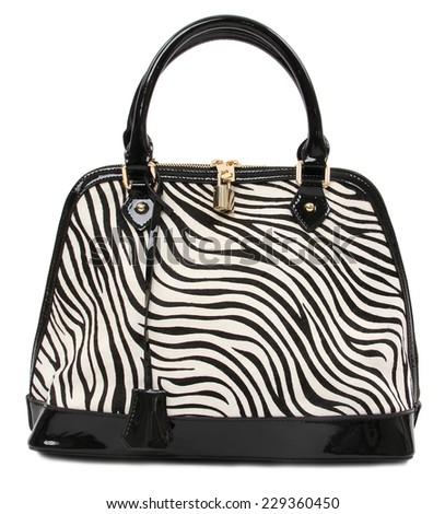 modern handbag with zebra pattern isolated on white bacground - stock photo