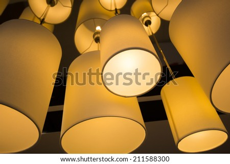 Modern hanging lamp in hotel. - stock photo