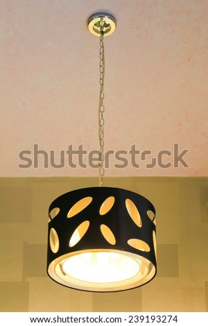 Modern hanging lamp on the ceiling. - stock photo