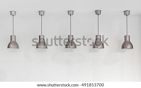 modern hanging lamp with light on ceiling