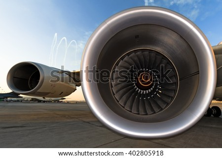 modern heavy large passenger airplane jet engine intake interior with second jet engine under wing side perspective panoramic wide fisheye detail exterior inside view technology transportation theme