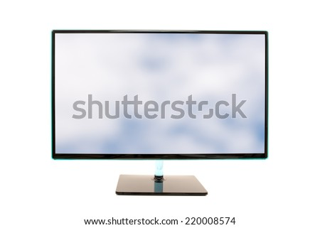 Modern high definition computer monitor with an image of a cloudy blue sky on the screen in horizontal orientation isolated on w white background.