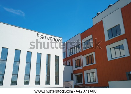 Modern high school building. Sunny day, blue sky. - stock photo